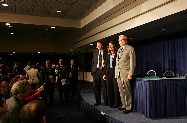 Warren Buffett with Bill Gates and Melinda Gates