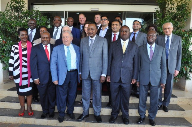 Mr. Yusuf Hamied and Cipla Quality Chemicals staff poses a group photo with President Uhuru Kenyatta