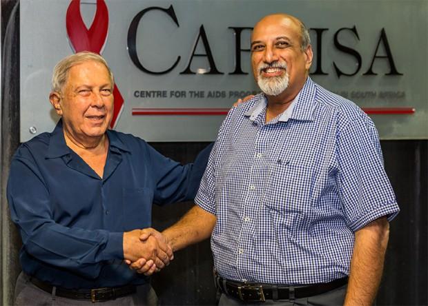 Prof Salim Abdool Karim shaking hands with Dr. YK Hamied