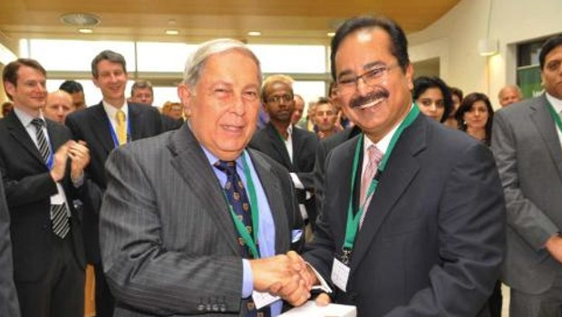 Dr Reddy's GW Prasad shaking hands with Yusuf Hamied