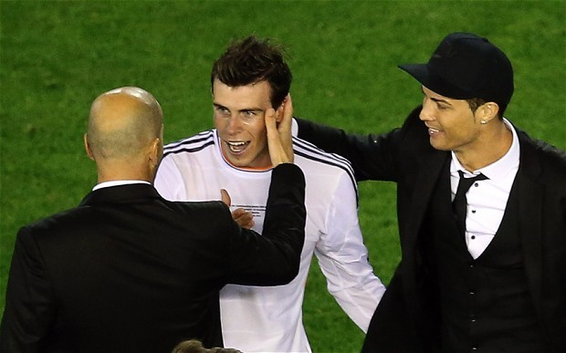 Gareth Bale celebrating with Zidane and Ronaldo