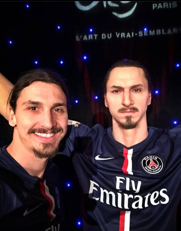 With His Wax Statue