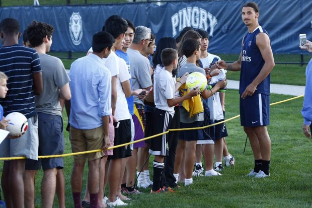 Zlatan signing autographs to fans